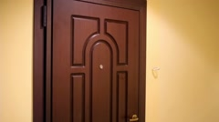 Brown front door to the apartment in a new building Stock Footage