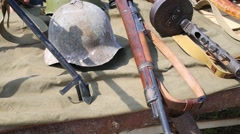 Weapons and helmet remained after the Second World War Stock Footage