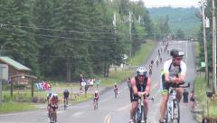 Salmini 10015-081015 - Cyclists down hill to camera Lake Placid Stock Footage