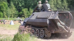 German soldiers are sits in an armored personnel carrier Stock Footage