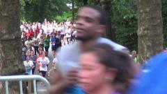 Salmini 10019-081015 - Runners by camera in background and foreground Stock Footage