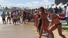 Salmini 10021-081015 - Women charge into Ocean at Waikiki Beach Stock Footage