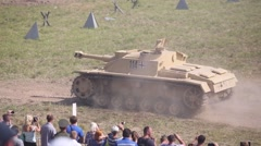 Spectators watch at German self-propelled gun Sturmhaubitze 42 Stock Footage