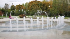 Round fountain in the park in the autumn public garden Stock Footage