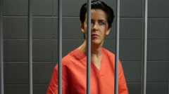 Female inmate in jail cell, pacing back and forth - stock footage