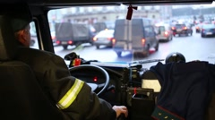 The driver of a fire truck at the wheel looks on the road - stock footage