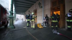Firefighters enters in a smoky building of the Bolshoi Theater Stock Footage