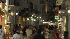 Tourists walking in island shopping street Stock Footage