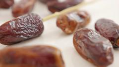 Delicious  palm dates  exotic fruit on white background slow panning  4K 2160 - stock footage