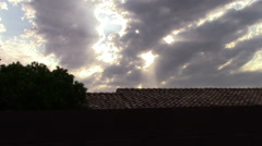 Sun Rays and Clouds over the roof, Windy Day Stock Footage