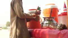 Kid preparing Thadal juice a wrestler's drink Stock Footage