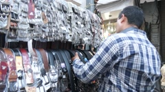 Selling leather belts in Karachi Bazar Stock Footage