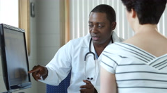 African american doctor consulting with a female patient Stock Footage