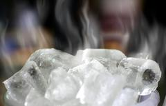 cold ice cube with white smoke - stock photo
