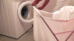 Woman using washing machine Stock Footage