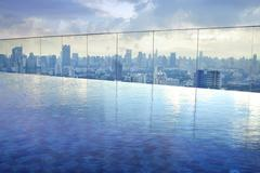 infinity pool on high condominuim building - stock photo