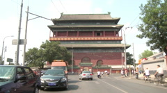 Car & bike traffic, Gulou Drum Tower, China Stock Footage