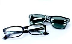 Glasses and sunglasses Stock Photos