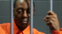 Black male inmate in jail cell, close up of his face Stock Footage