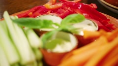 Cut into julienne vegetables and sauce on a plate in a restaurant Stock Footage