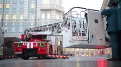 Rescuers stand at the cradle of fire motor ladder at fire drills Stock Footage