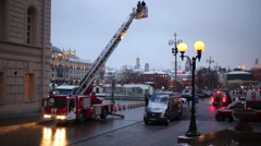 Stock Video Footage of Fire motor ladder with reporter and fireman rises up at fire drills