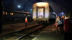 Passengers looks at the dock of train carriages at the station Stock Footage