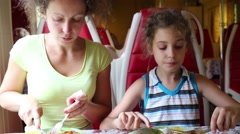 Mother and daughter has lunch in the restaurant car of in the train Stock Footage
