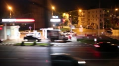 Cars moves along city streets at night, view from a moving train Stock Footage