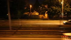 The road next to the railway at night, the view from moving train - stock footage