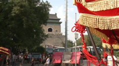 Beijing Bell Tower, pedicabs, tourists - stock footage