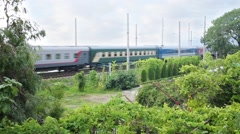 Train with the acronym RZD moves by rail next to the garden Stock Footage