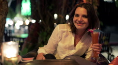 Portrait of happy woman drinking cocktail and enjoying party in cafe at night Stock Footage