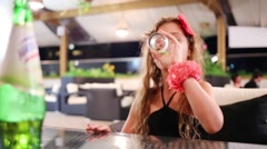 Little girl drinks sparkling water in a restaurant Stock Footage