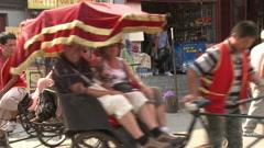 Tourist pedicab ride, Beijing, China Stock Footage