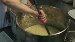 Cook pouring mashed potatoes with ladle in pot, puree close up. Stock Footage