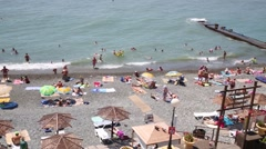 Equipped public beach with lots of people on the Black Sea Stock Footage