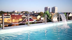 The fountain in the outdoor rooftop pool against the city Stock Footage