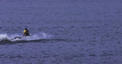 People having fun on a jet ski on an open lake Stock Footage
