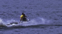 Young men having fun on a jet ski Stock Footage