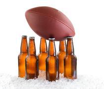 Six pack of bottled beer holding up American Football isolated on white backg Kuvituskuvat