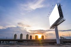 Large blank billboard with city view and background Stock Photos