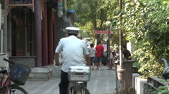 Chinese man on moped, Beijing alleyway - stock footage