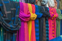 Colorful of scarves in a textiles market Stock Photos