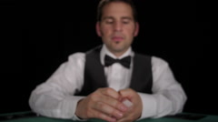 CU of dealer revealing the ace of diamonds to camera Stock Footage