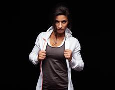 Tough young fitness woman - stock photo