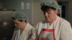 Female cooks preparing cheese pies in kitchen, tilt down, traditional food. Stock Footage