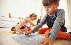 Children drawing and coloring at home - stock photo