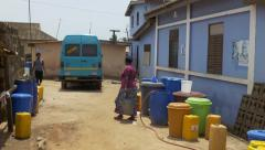 Ghana local woman carry water bucket 4K Stock Footage