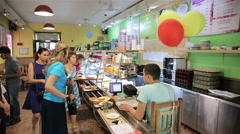 Visitors to the canteen and take meals are paying at the checkout. - stock footage